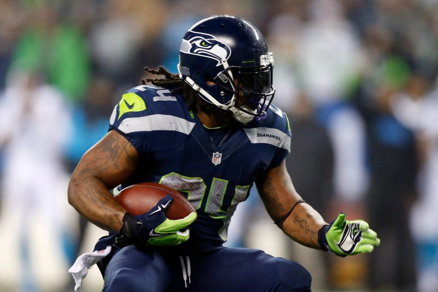 SEATTLE%2C+WA+-+JANUARY+10%3A++Marshawn+Lynch+%2324+of+the+Seattle+Seahawks+runs+the+ball+against+the+Carolina+Panthers+during+the+2015+NFC+Divisional+Playoff+game+at+CenturyLink+Field+on+January+10%2C+2015+in+Seattle%2C+Washington.++%28Photo+by+Otto+Greule+Jr%2FGetty+Images%29
