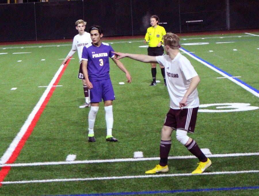 Boys Soccer senior Scott McClellan points ahead to direct his teammate forward in the Islanders' second home game against Highline. Mercer Island would go on to win 1-0 in a tightly contested defensive battle.